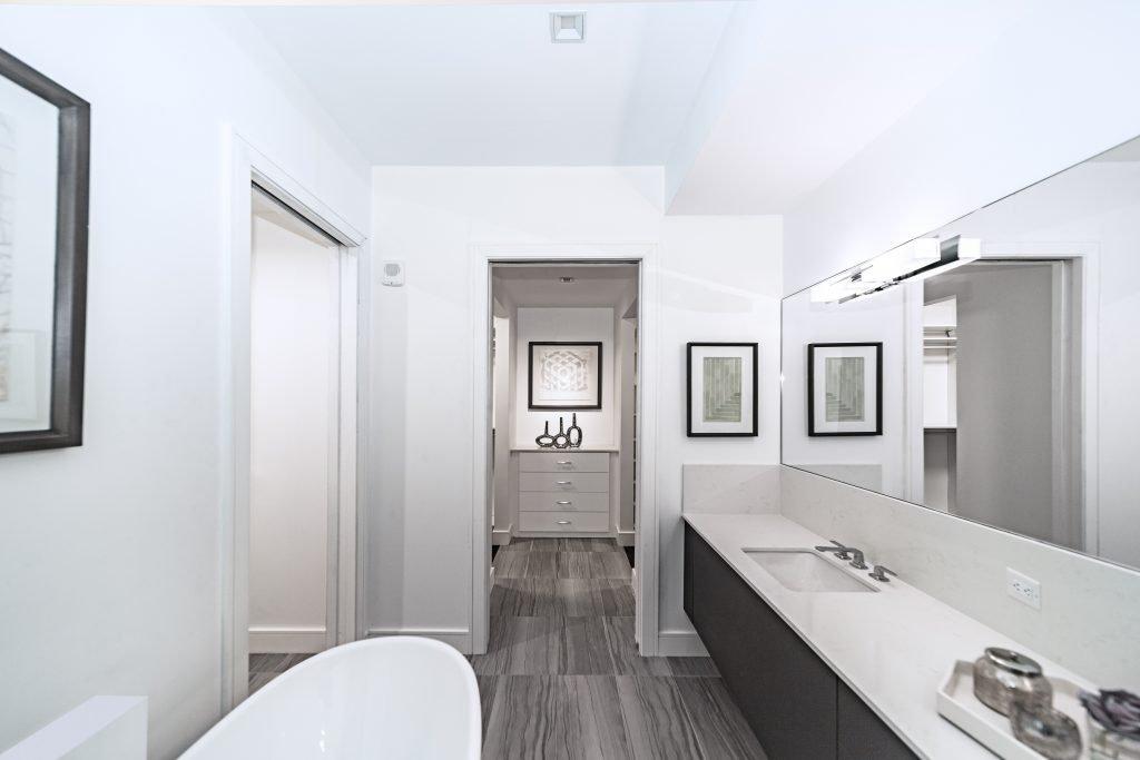 white ceramic bathtub near white ceramic bathtub