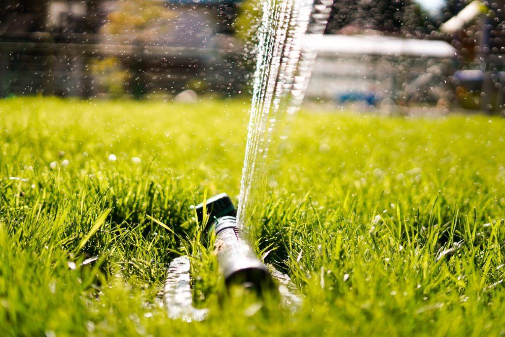 water sprinkler outside in grass