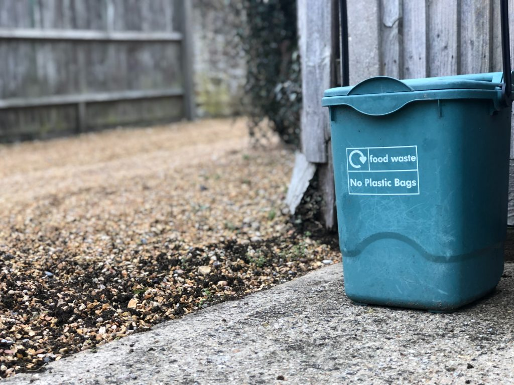 blue food waste can outdoors