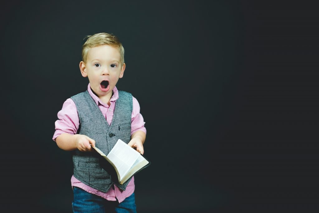 boy-with-book-in-hand-with-mouth-wide-open