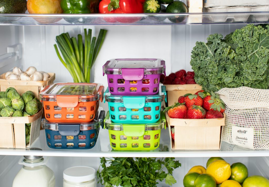 view of inside of fridge with containers and fruits and food in it