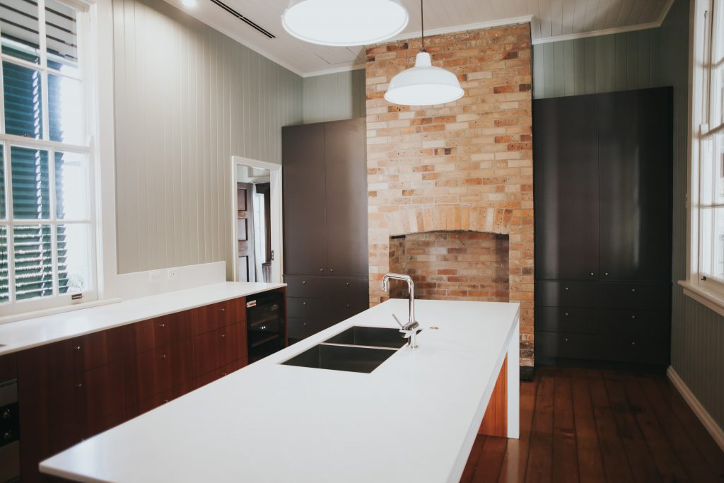 kitchen island with red brick wall in the background