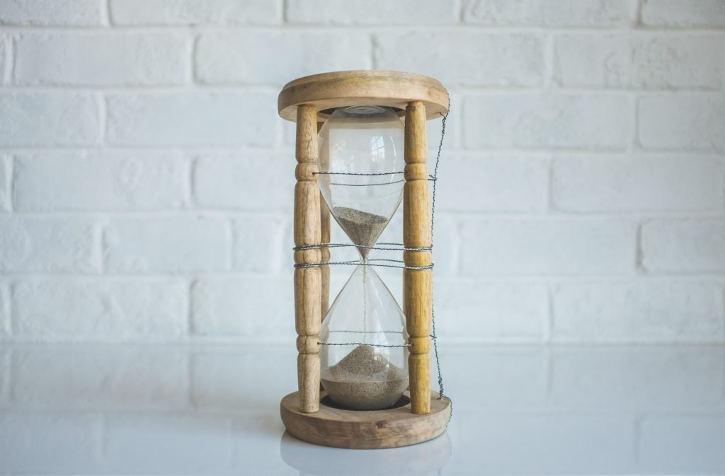 wooden hourglass half full