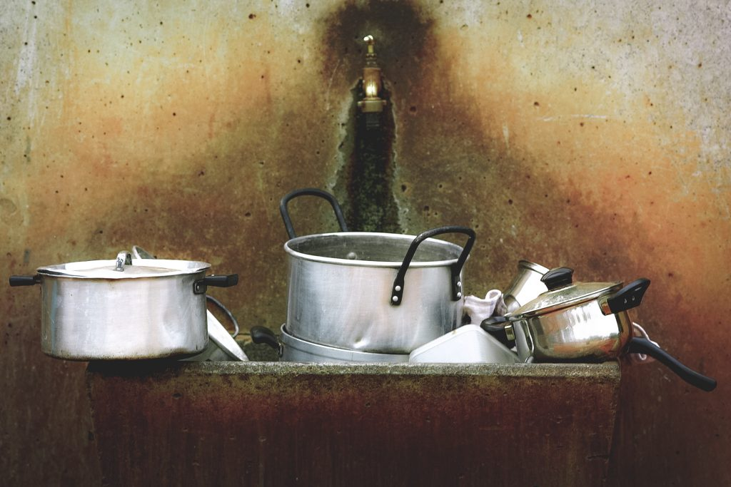 pots and pans in sink