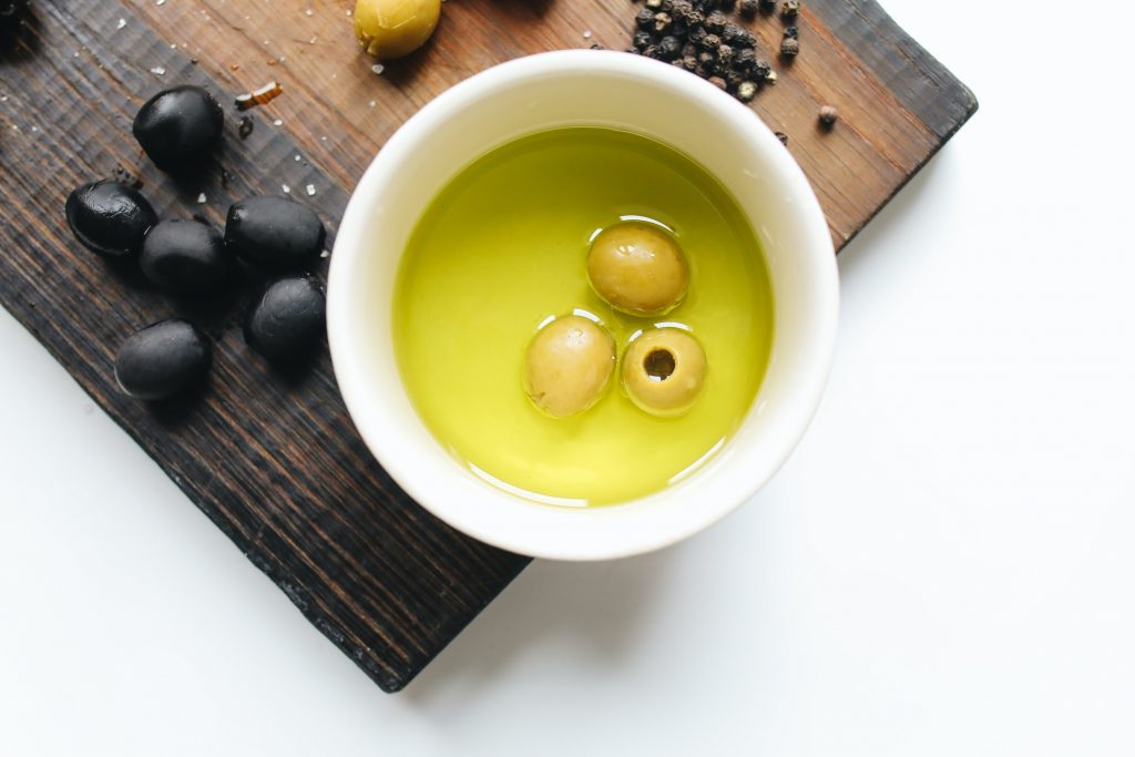 oil in cup with olives