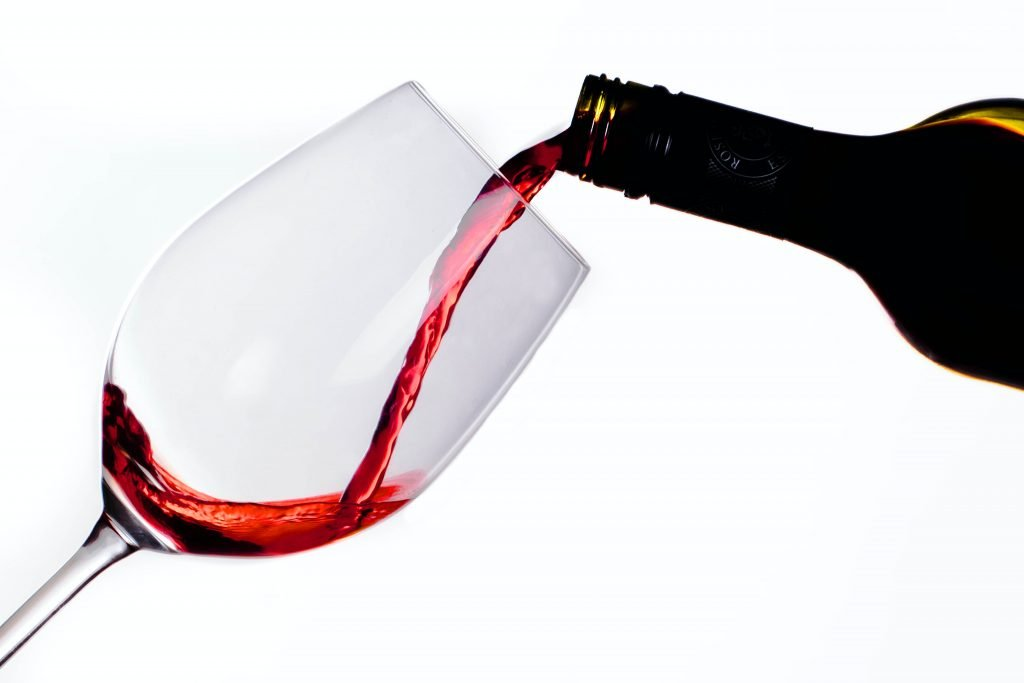 wine being poured in bottle